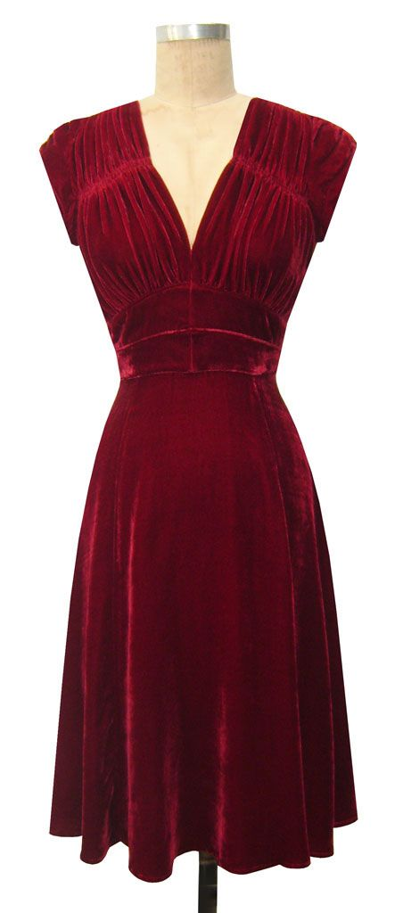 Drop dead gorgeous 1940's red dress. I wish I could have lived then. The clothes were so powerfully feminine.