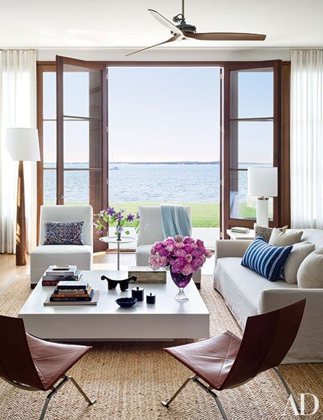 For his home in Sag Harbor, New York, architect Frank Greenwald hired decorators Foley & Cox to create relaxed, comfortable interiors. In the living room, the duo placed a linen-clad Christian Liaigre sofa and a pair of Poul Kjærholm leather-and-steel lounge chairs from Republic of Fritz Hansen around a cocktail table by FTF Design Studio.: