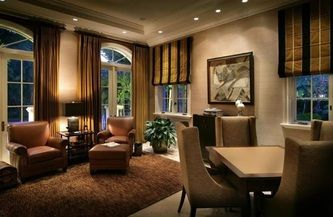 Roman blinds and matching curtains creates a strong masculine home decor