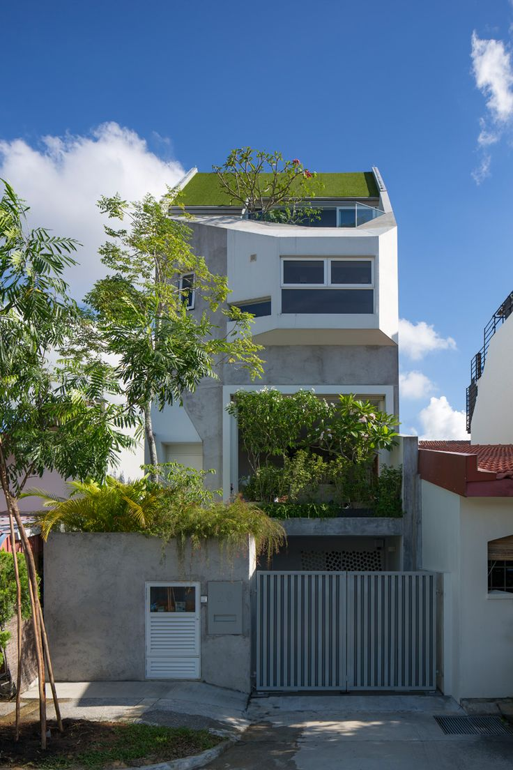 Several levels of tiered open spaces are found inside this new house in Singapore
