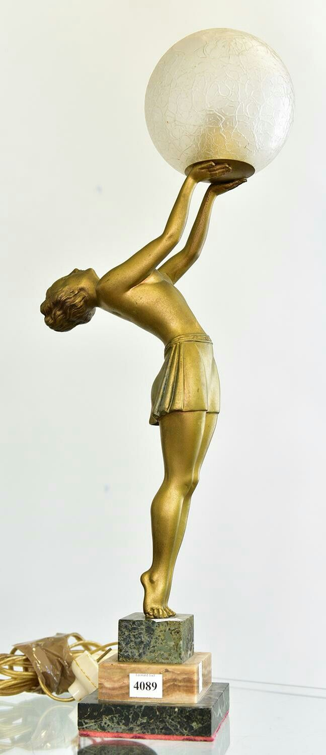 AN ART DECO FRENCH BRONZE TABLE LAMP OF A FEMALE ON MARBLE BASE, 1930's.