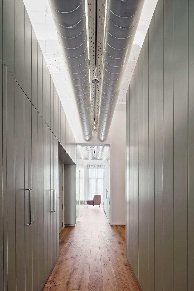 Bonba Studio has transformed an office in Barcelona into a two-bedroom flat featuring traditional vaulted ceilings and multi-hued surfaces.