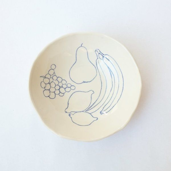 This large 'fruit' serving bowl is hand built and is accompanied by a fun still life drawing of fruit by catherine rex. this unique bowl will add an eye catching quality to your dishwear or is the perfect gift.    rex design ceramics are hand made and trimmed with love and care creating truly one of a kind pieces. due to the nature of throwing and glazing ceramics may vary in size and design.    light stoneware    clear glaze    original drawing    about 11 inches in diameter and about 2.75…