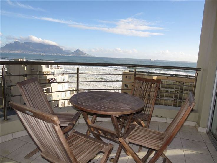 Oceanview Beachfront Apartment - Enjoy a sundowner on the balcony absorbing magnificent views of the iconic Table Mountain, Robben Island and Lion's Head. Inhale the fresh sea breeze from the Atlantic ocean, marvel at the colourful kites ... #weekendgetaways #bloubergstrand #capemetropole,blaauwberg #southafrica
