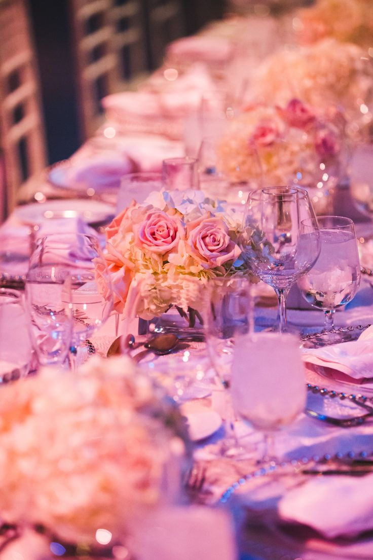 Stunning Table Décor - Clear glass votives with white hydrangea's and blush roses http://www.fusion-events.ca/