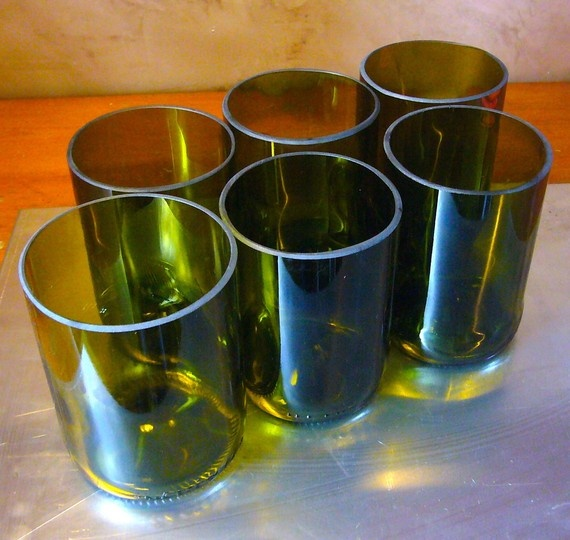 Water glasses made from Italian wine bottles by our friends at Metamorphosi.