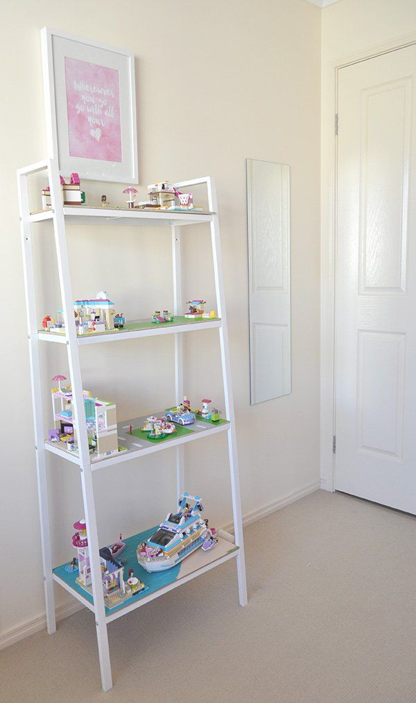 The boards slide off the shelves, so kids can play on the floor with different scenes, and they stay put together. I bet a smaller cubby shelf would work for a Lego base plate, too.