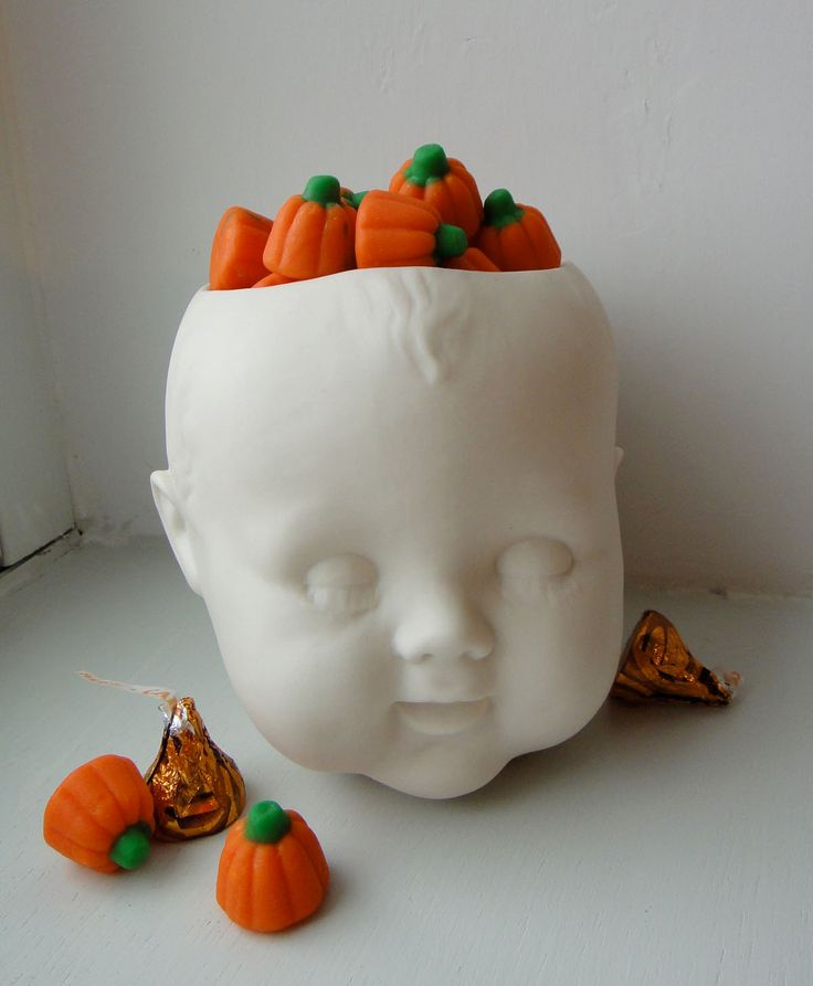 For a festive Halloween.   -   Maybe you could get a vinyl doll head, cut off the top and paint it