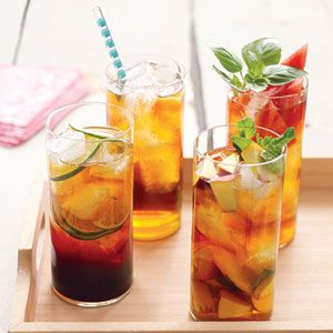 Peach and Mint Iced Tea Recipe, Ingredients: 8 cups/ boiling water/ 8 tea bags/ 4 ripe peaches cut into 1/2-inch pieces/ 1 small bunch fresh mint sprigs/ Sugar, to taste (if desired)/