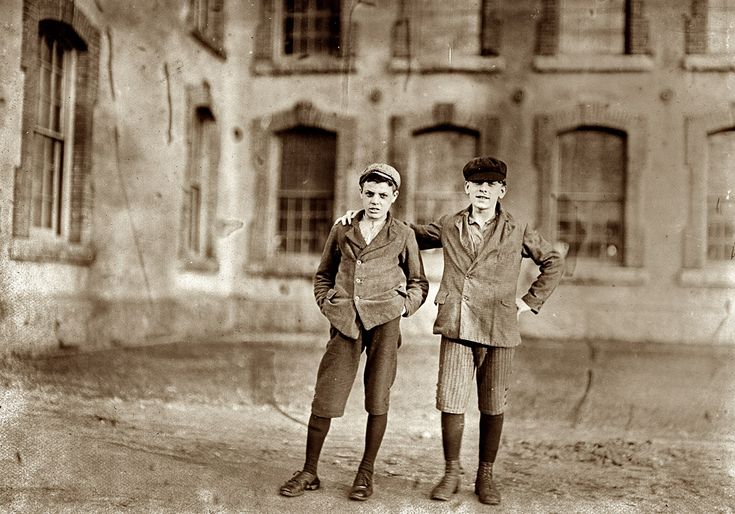 Two Boys Working: 6 p.m., April 16, 1909. Anthony, Rhode Island. Two boys working in Coventry Company Mill. I saw about 10 boys and girls who looked to be under 14 years of age. Photo and caption by Lewis Wickes Hine.
