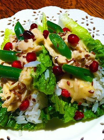 Colorful and delicious! If you stuffed yourself with too much food this holiday, here's a nice light alternative.  Make an after Christmas, Christmas salad. Romain, chicken with chicken gravy, Jasmine rice, Pomegranate seeds, flax seeds, bias cut green beans. Nice warm or cold.