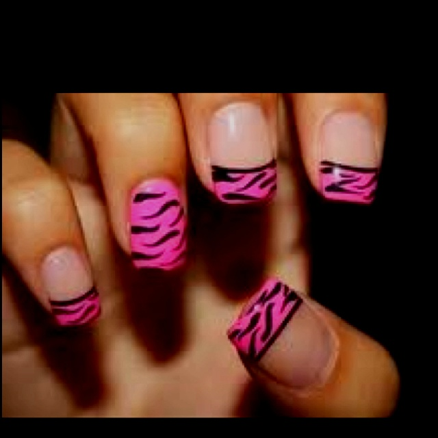 pink and black zebra. You'd think these were my nails. Totally my style with the ring finger solid.