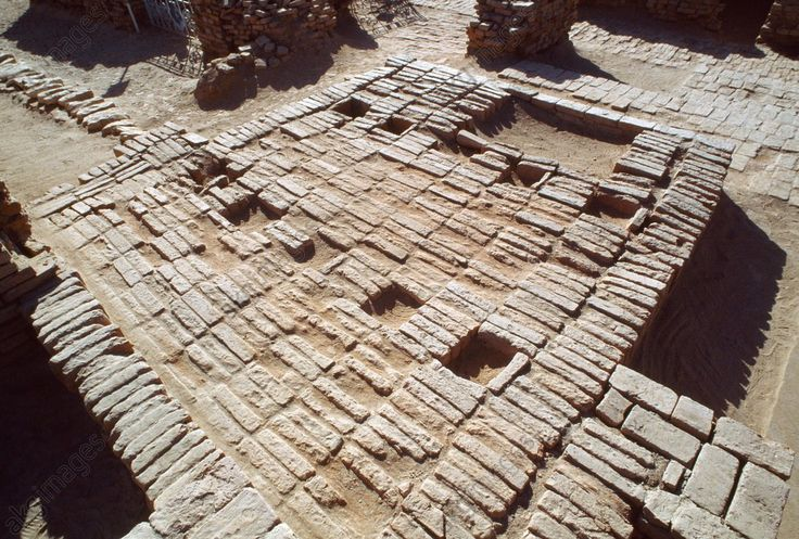 Floor of a room with vessel furnaces in a town of the Mohenjo Daro archaeological site (UNESCO World Heritage List, 1980), Pakistan. Indus civilization, 3rd millennium BC.