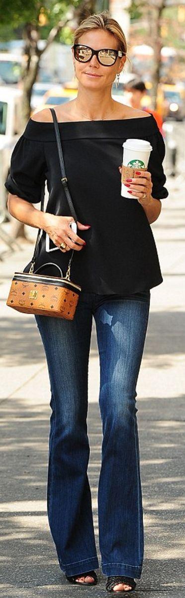 Who made Heidi Klum's brown handbag, black off the shoulder top, and jeans?