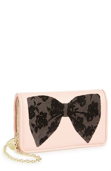 Free shipping and returns on Betsey Johnson 'Flocked Bows' Crossbody Wallet on a Chain at Nordstrom.com. A velvety Betsey Johnson bow adds flirty-fun appeal to a sleek wallet crossbody finished with an optional, gilded chain strap for a hands-free carrying option.