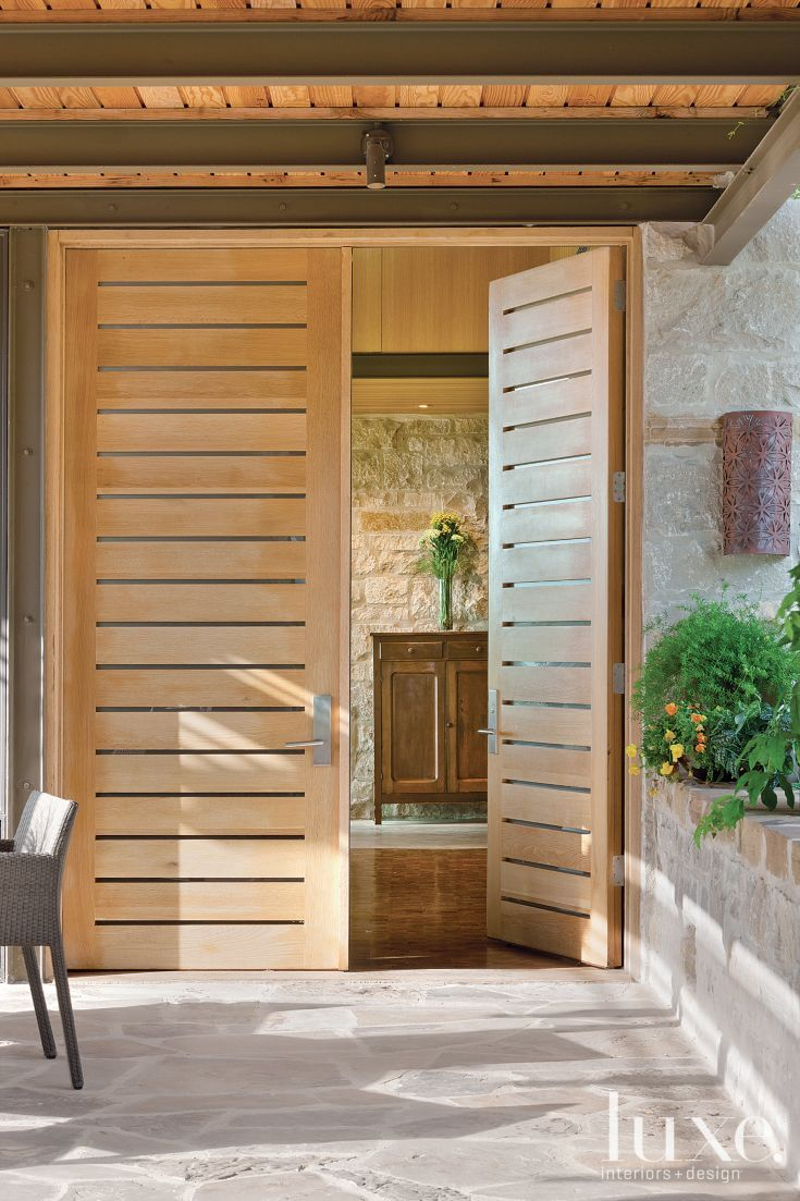 Slatted rift sawn wood and glass door