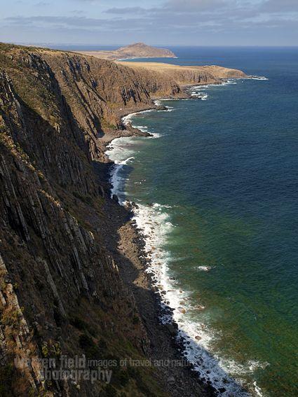 Waitpinga cliffs, with Victor Harbor's Bluff beyond. Warren Field photography: http://warrenfield.wordpress.com/2011/04/05/hiking-the-heysen-trail-in-south-australia-australian-geographic-2/
