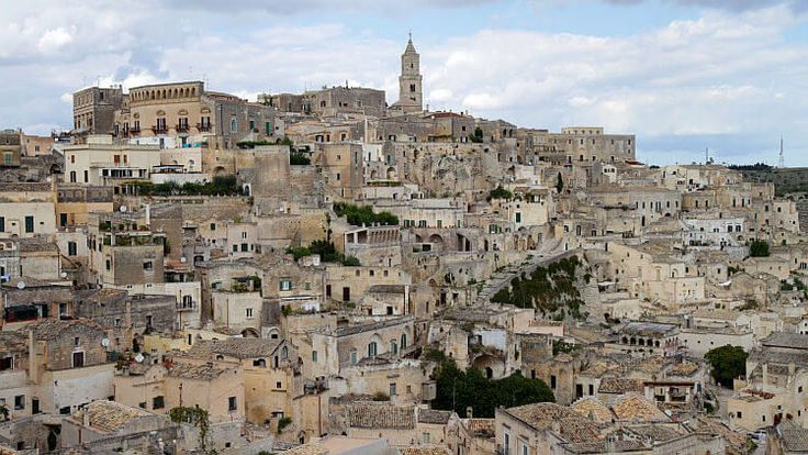 See cave houses and churches in Matera, southern Italy.