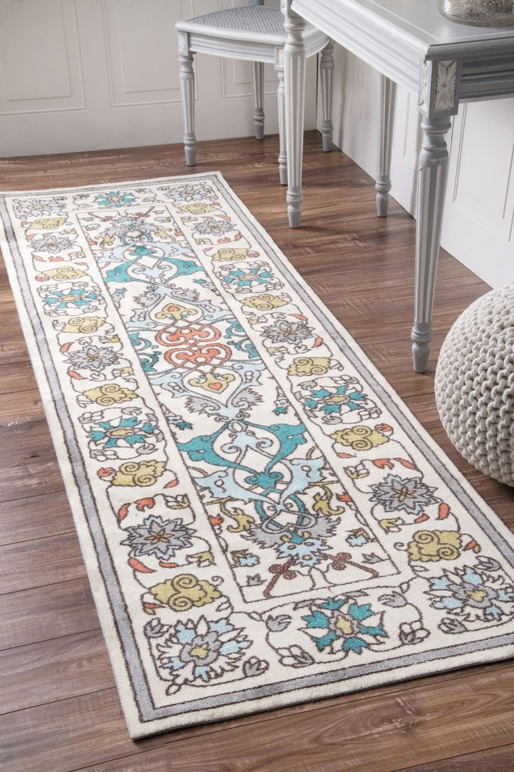 Machine mMade out of 100% polyester, this eclectic area rug is easy to clean and extremely soft underfoot. The vibrant colors in this transitional styled rug are sure to stand out in any room.