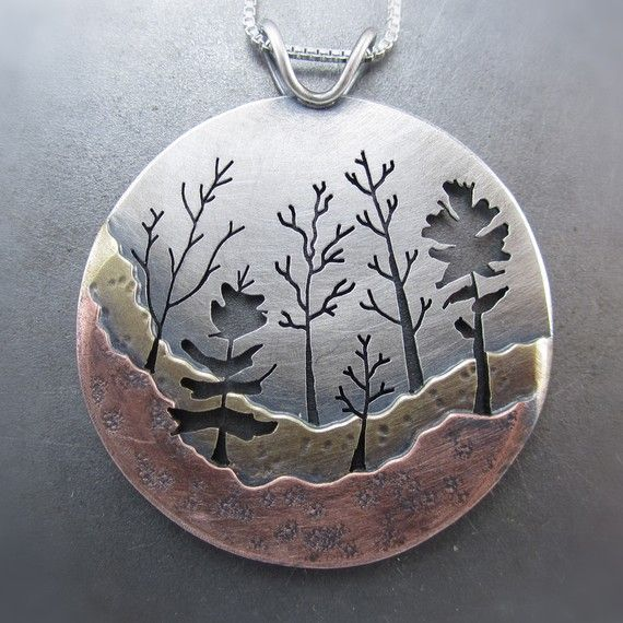 Neat piercing and layering of metals...Large Woodland Forest Copper, Silver and Brass Pendant by Beth Millner