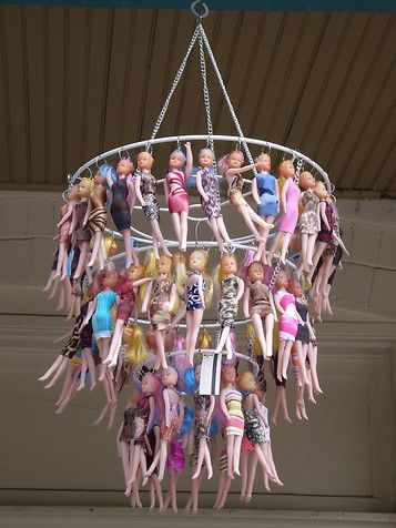 this recycled Barbie chandelier is kitchy, princess-y, and barbaric all at the same time!