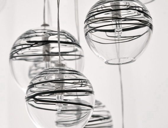 Aire Lamps. Hanging round glass pendant lights, available in multiple configurations, hand made, blown by artisan glass makers. By Seltia.pl