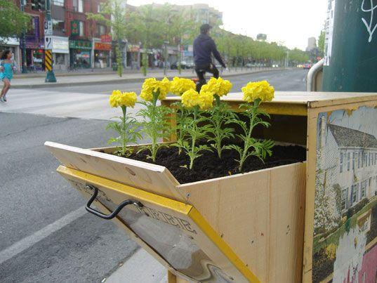 news box upcycled to flower box :)Boxes Gardens, Guerilla Gardens, Urban Art, Street Art, Urban Gardens, Guerrilla Gardens, Paper Boxes, Planters Boxes, Flower Boxes