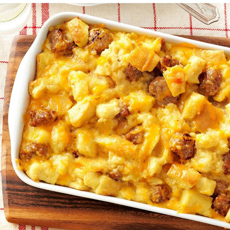 Sausage and Egg Casserole Recipe -For the perfect combination of eggs, sausage, bread and cheese, this is the dish to try. My mom and I like it because it bakes up tender and golden, slices beautifully and goes over well whenever we serve it. -Gayle Grigg, Phoenix, Arizona