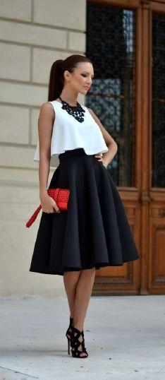 Black skirt, white blouse, red purse...  Stylish