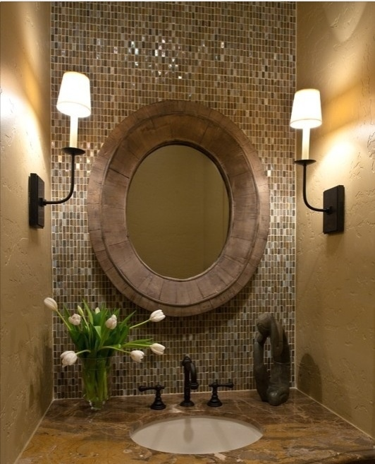 i like the idea of tile behind the mirror, and interesting placement of lights.