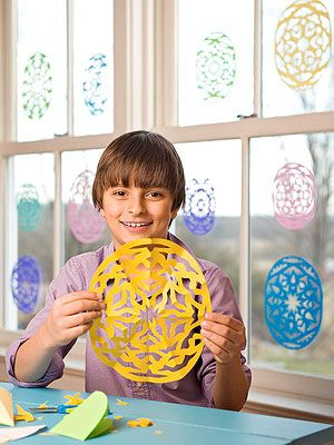 Snowflake Eggs: These lacy decorations are made using the same technique you'd use for classic paper snowflakes.