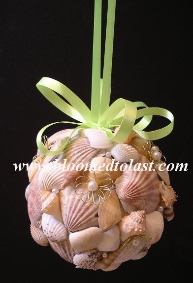 This hand made shell pomander can be used for your flower girl, bridesmaids or to decorate the aisle of your destination wedding. www.BloomedToLast.com WV, VA, MD, DC Wedding   Event & Wedding Design & Planning   Bloomed To Last