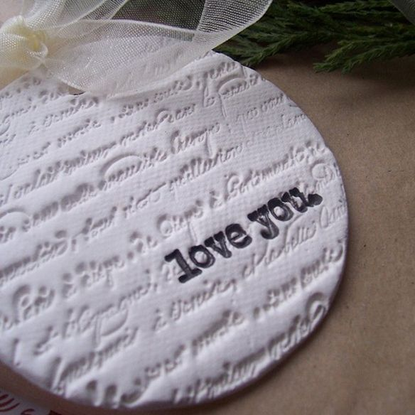 Pretty Salt Dough Ornaments1 cup salt, 2 cups all purpose flour, 1 cup luke warm water  Simply roll out the dough, stamp with a custom stamp to match your logo or scrapbooking stamps in the ink color of your choice and then cut out with a cookie cutter that matches your desired size. Poke a hole in the top and then set out to dry.
