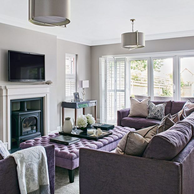 Light grey living room with lilac sofa