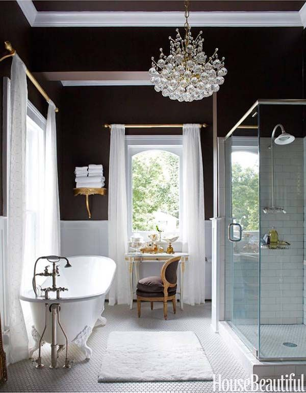 In an antique-filled Victorian house in Illinois, designer Annie Brahler  chose the master bath's rich brown paint to play up the brilliant whites of  the tub ...