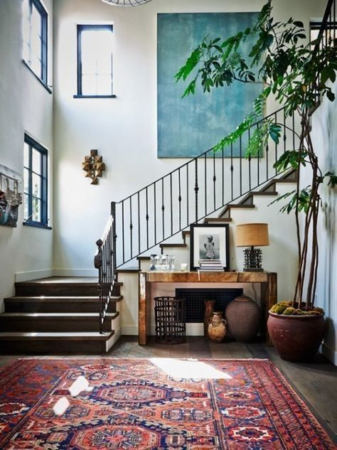 patterned area rug, white walls minimal décor style, large plant in living room décor, #largefoyerdecorating