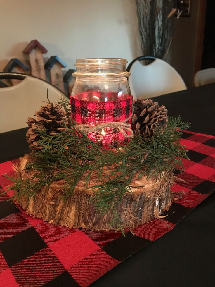 Lumberjack baby shower centerpieces. Cedar slice, cedar greens (no sap leakage), pine cones, and a mason jar with a tea light