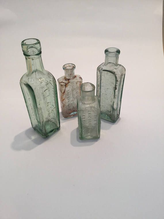 Group of mixed vintage and antique medical/alcohol/drink glass bottles circa 1920s