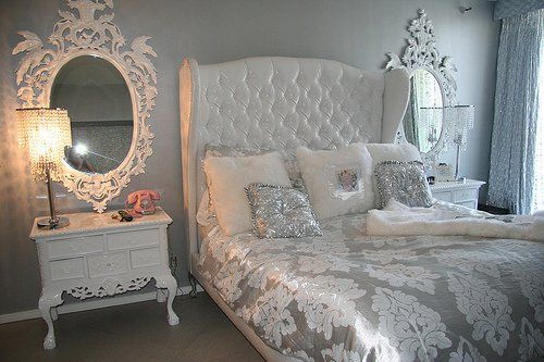 Quite the dream bedroom - white silks and satins with touches of Rococo and good old Hollywood glamour for a totally luxurious and sumptuous look.