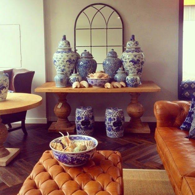 PORTOBELLO - HOME Blue and white drum stools, tan leather, European oak herringbone floors, reclaimed timber table, sisal floor rug.