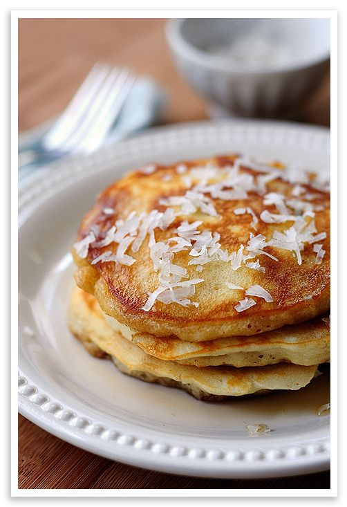Coconut pancakes   1 1/4 cup all-purpose flour  2 tablespoons sugar  1 teaspoon baking powder  1/2 teaspoon baking soda  1/4 teaspoon salt  1/4 cup shredded, sweetened coconut  1 egg, beaten  1/2 cup buttermilk  3/4 cup coconut milk (NOT coconut water, although that's tasty stuff)  1 tablespoon melted butter (I used salted.)  additional butter or cooking spray for cooking surface
