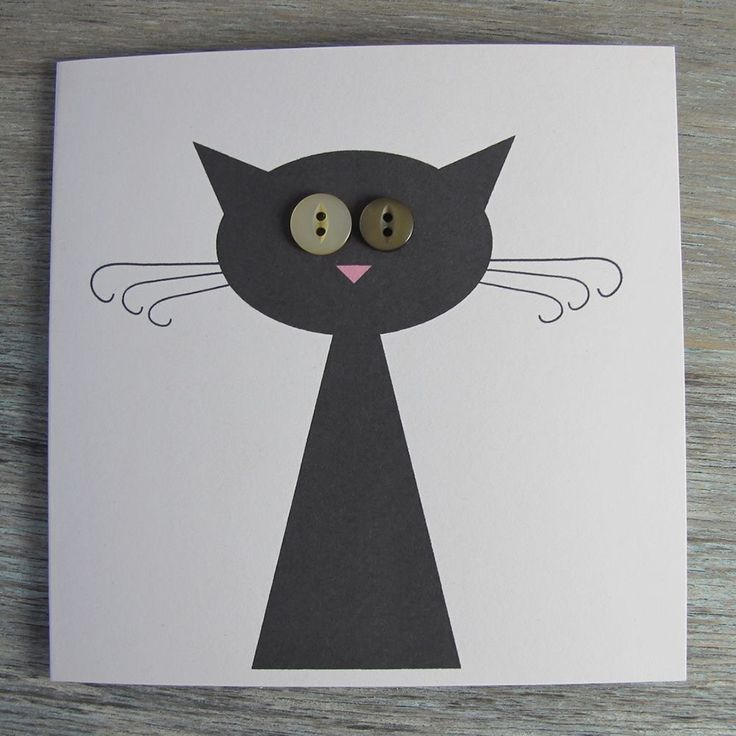 Kitty shape with large pointy triangle, oval for head and two small triangle ears in fondant