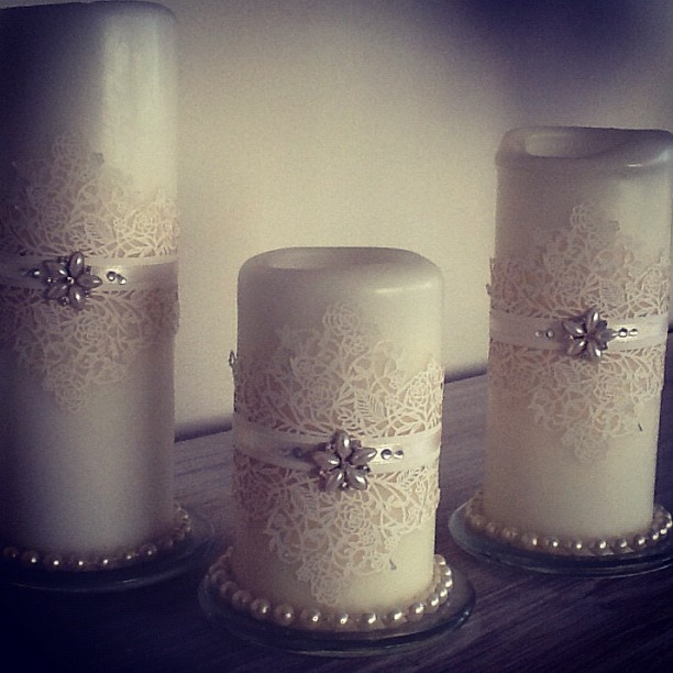 DIY candles - normal candles, cheap string of costume pearls, laser cut paper flower stencil and ribbon