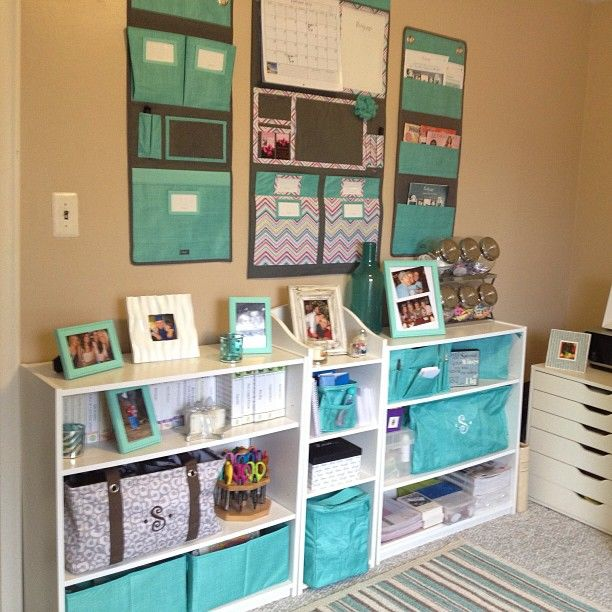 """A perfectly organized space featuring our Room to Grow Utility Bin (bottom left), Large Utility Tote (marked with """"S""""), Hang-Up Room Organizer, Hang-Up Home Organizer, Hang-Up Family Organizer (featured L to R), Keep It Caddy, Zipper Pouch (both on top right shelf), Littles Carry-All Caddy (middle top shelf) and Single Organizer (bottom middle shelf)."""