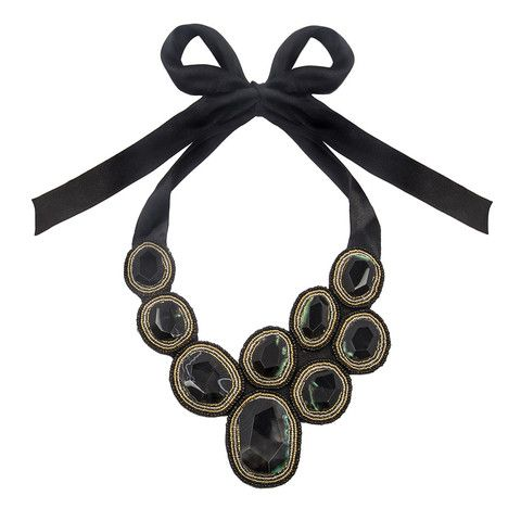 Our beautiful Cristina Necklace is hand beaded on black felt fabric making it very light and comfortable. It has 38cms of ribbon so you can adjust it to your desired length.