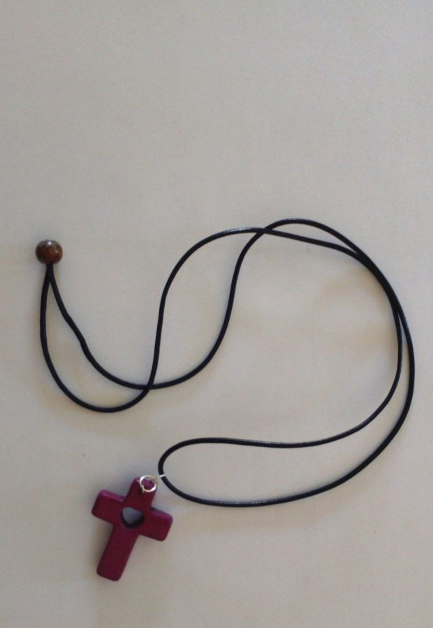 Leather necklace with cross.