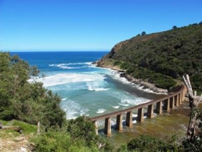 Situated directly above the Kaaimans River mouth with the most beautiful views of the Indian Ocean and Kaaimans River gorge. The railway bridge below spanning the River was once used daily by the world renowned Outeniqua Choo Tjoe steam train which ran between George and Knysna