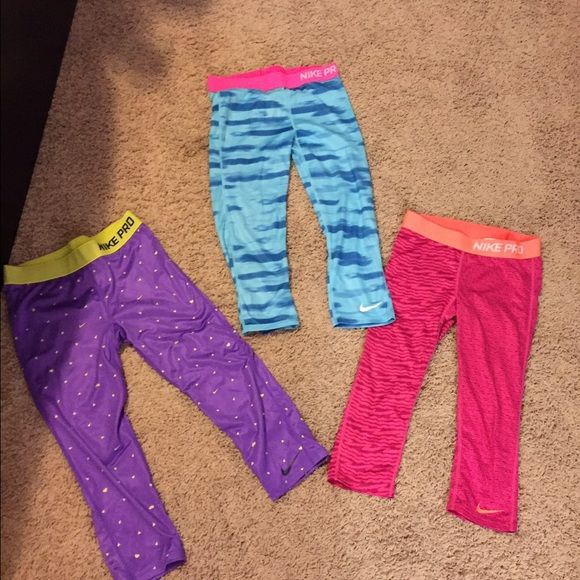 Nike leggings children sizes fit like Adult small Nike legging bundle sizes child L and XL fit like adult small great condition not work at all Nike Pants Leggings