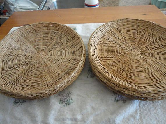 These are a lot of 8 wicker woven paper plate holders. Only one has its original sticker on the bottom, which states handmade in China BK fabriquela mainen chine. All look to be in wonderful vintage condition. These are great for your parties, camping, buffets or pizza night.