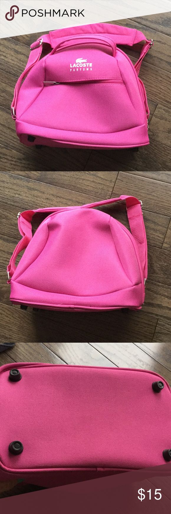 ☘️☘️ Travel tote bag Lacoste pink travel tote bag with adjustable carrying strap. Has 2 elastic pockets on the inside. Never been used! If there was a tag it would still be on. Lacoste Bags Travel Bags